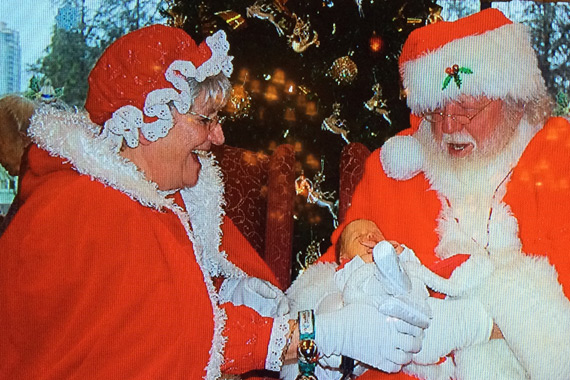 Santa Claus & Newborn Baby